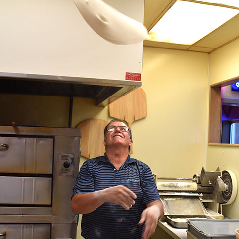 Dave tossing dough